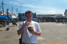 Enjoying a coconut